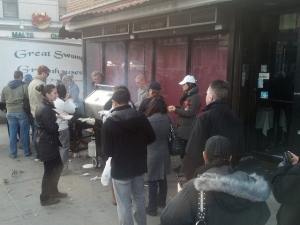 A Local Merchant Giving Hamburgers to Hoboken Residents